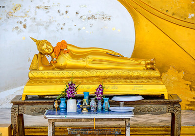 Smaller reclining Buddha in front a a larger Buddha at a temple in Bangkok, Thailand.