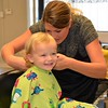 Beaux getting his first haircut.
