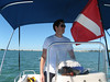 Captain Cullen mans the boat while the divers are in the water.