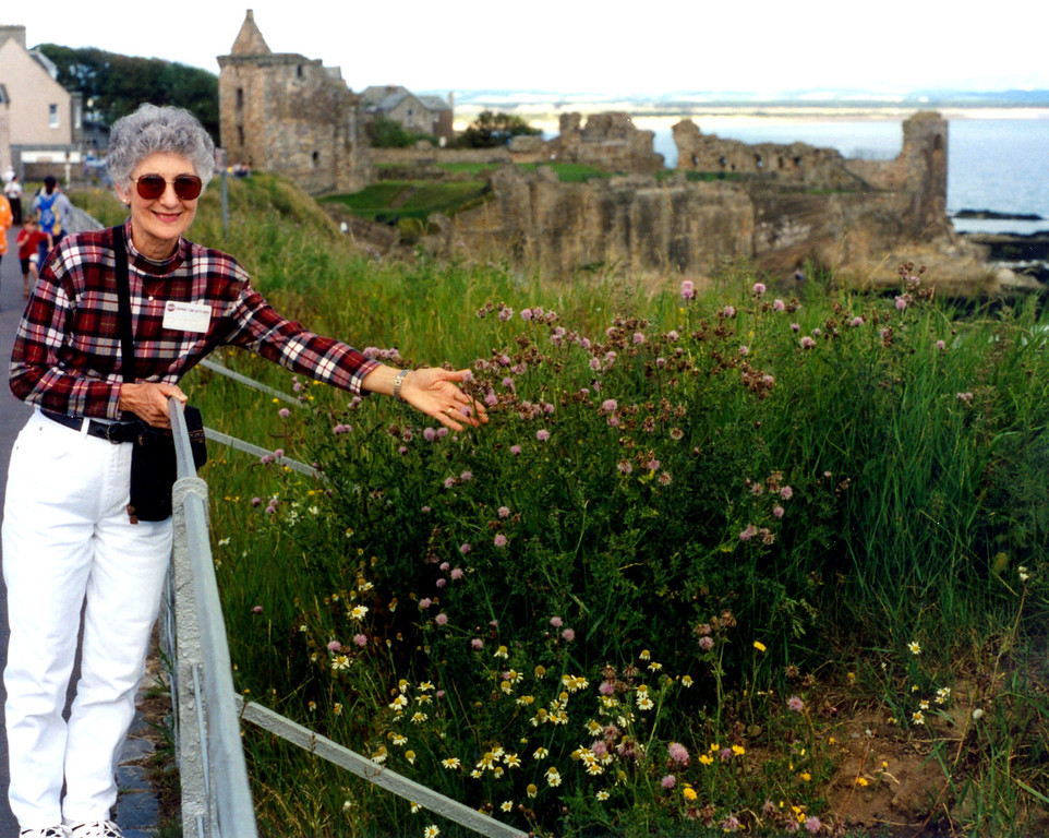 1997-07-27 Betty admires flowers in St Andrews.