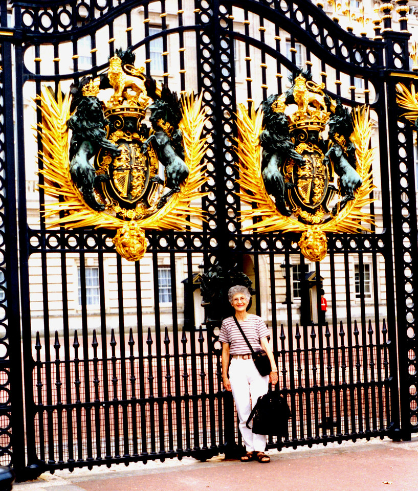 1997-08-02 Betty at the gates of Buckingham Palace.  We had tea with the queen on my birthday.