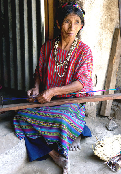 Mar 18.  We took a boat ride around a lake and stopped at San Antonio Palopo.  There we visited an Indian's home.  This is his wife, at the entrance to the home with dirt floors and sparse furnishings.