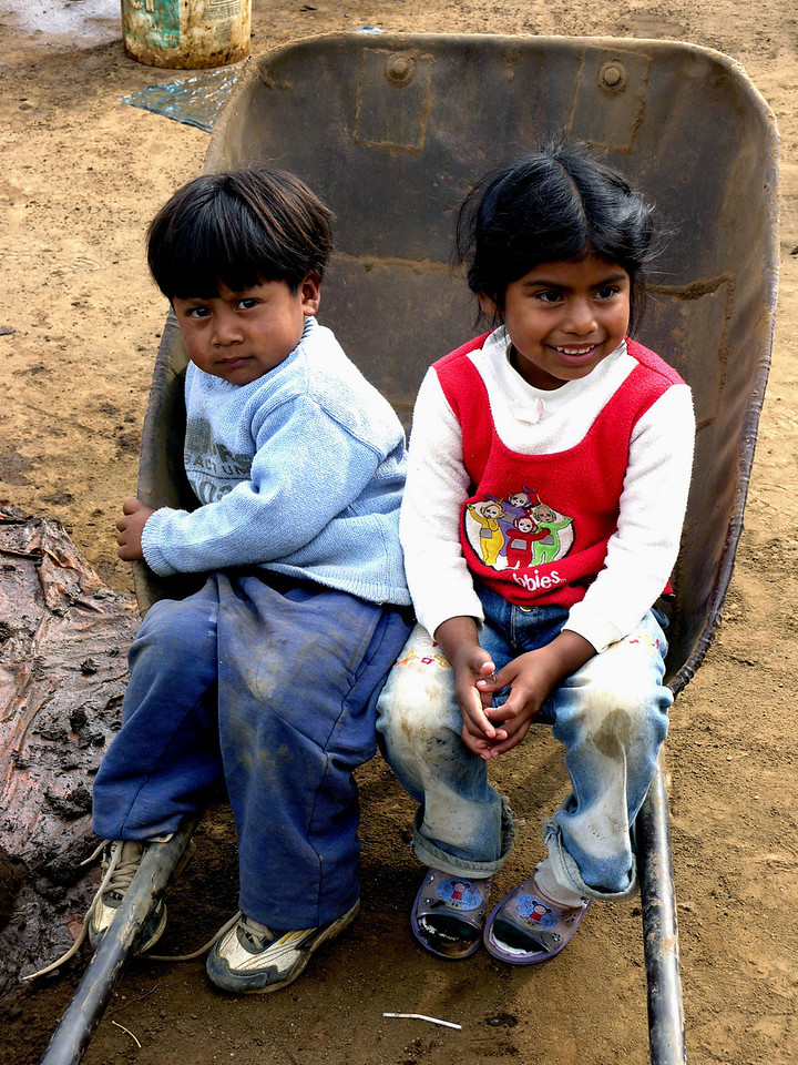 Mar 18.  We stopped at a kiln where clay bricks are made, owned by the same family at least three generations.  Teenagers and pre-teens worked at brick making, but not these two.