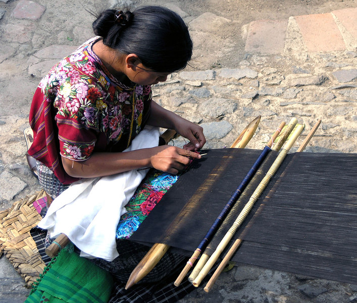 Mar 17.  A girl weaving and selling her wares near the restaurant.