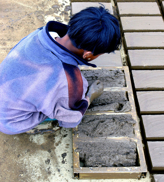 Mar 18.  One of the young boys, maybe six or seven, making bricks.
