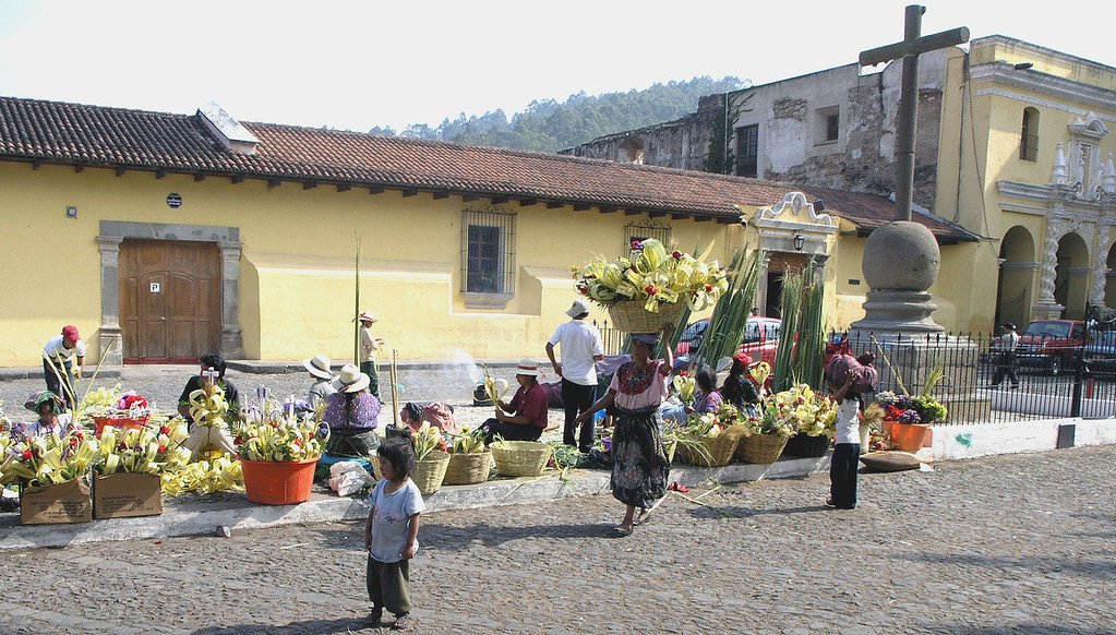 Mar 19.  In the city square people sold flowers.  One lady carried a basket of flowers on her head.