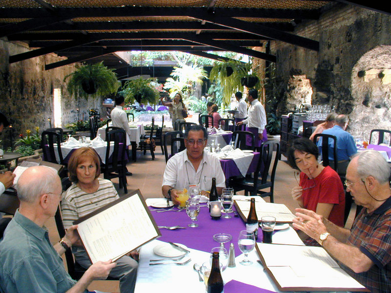 Mar 17.  The other end of the restaurant, and our tour leader, Julio, at the head of the table.