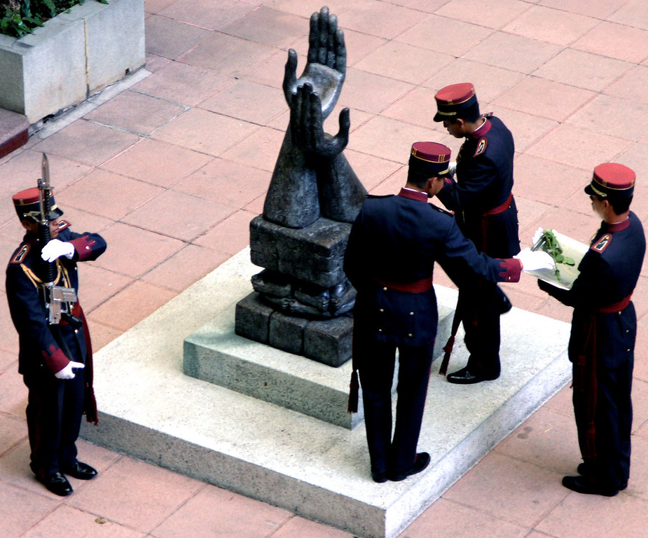 Mar 17.  At the National Palace we watched the changing of the rose, a ceremony in memory of Guatemala's freedom.  Each day a new rose is placed in the palm of that hand, and the old rose is presented to a different lady of Guatemala City.