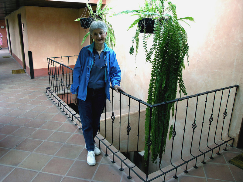 Mar 19.  After breakfast we returned to our room and Betty poses by a fern near our door.