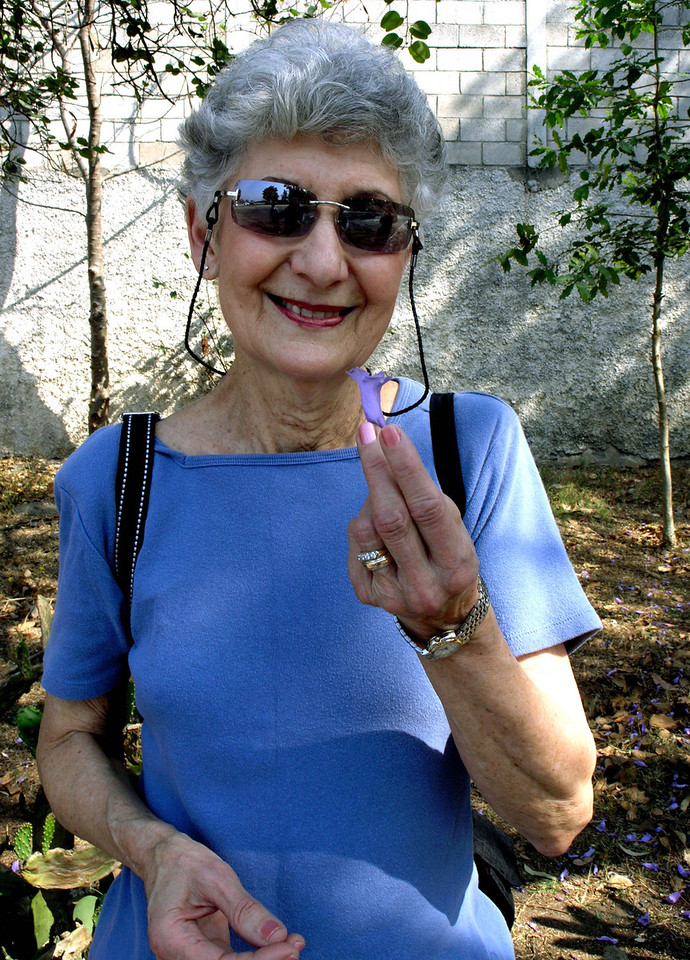 Mar 17.  We toured a city park in Guatemala City.  Betty holds a flower petal.