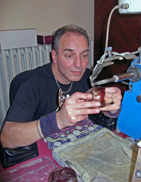 April 14.  At the Rott Crystal shop we observed this man engraving cups and other things.