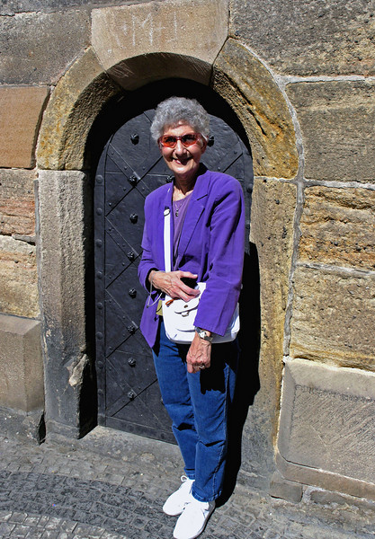 April 14. Betty is standing in front of the door of the Old Town Hall directly under the astronomical clock.
