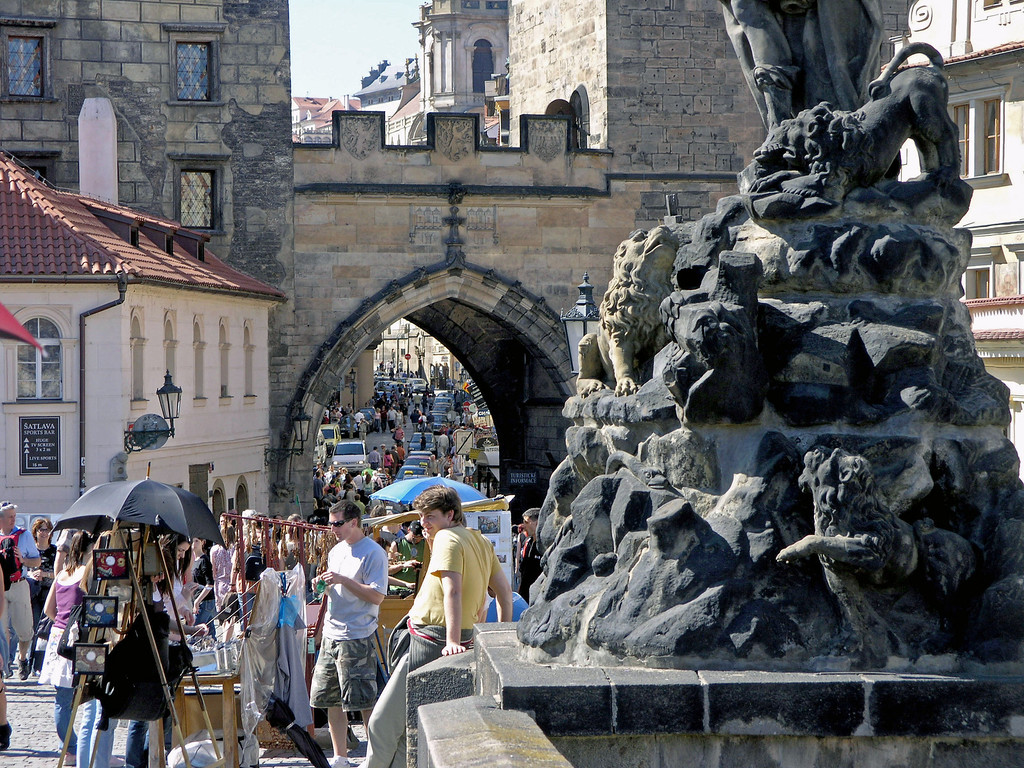 April 14.  We walked across the Charles Bridge and at the other end is this gate, the Gothic Old Town Bridge Tower, built at the end of the 14th century, considered the finest Gothic tower in central Europe, mainly for its decoration.