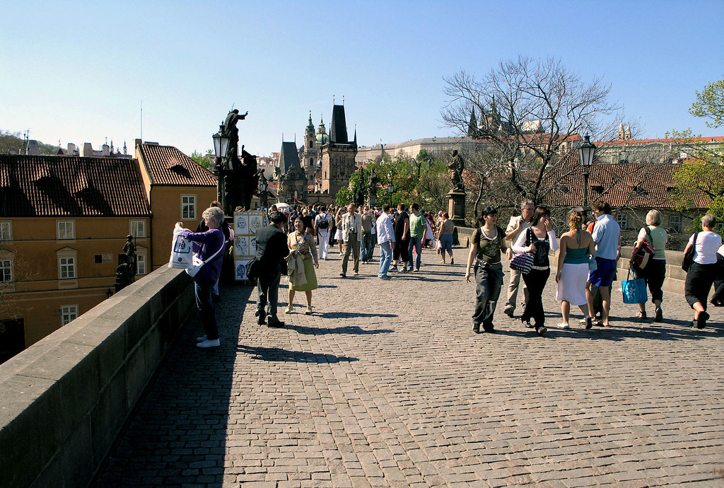 April 14.  In early afternoon we walked across the Charles Bridge, Prague's most familiar monument.  Its foundation stone was laid 1357 July 9 at 5:31 a. m.  It was believed the sequence of numbers made by this date and time ( 1357 9 7 531) would secure successful construction.  It was completed in 1400.  It withstood wheeled traffic for 600 years, but today only pedestrians travel the bridge.  Betty, to the left, takes a picture.