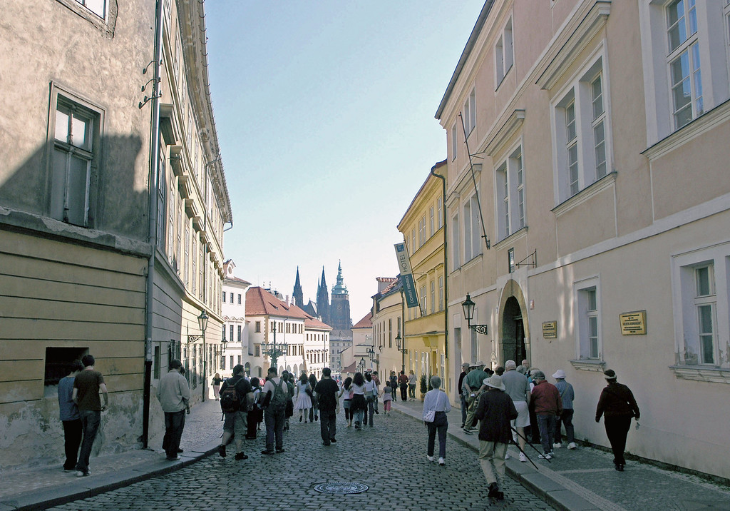April 15.  Walking through Prague.  Betty has her white purse over her shoulder.