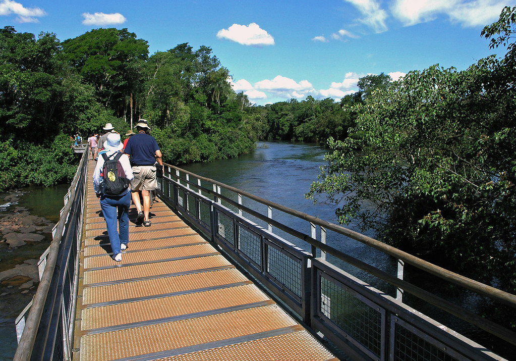 """Nov 4. On the trail to the falls. The """"trail"""" is actually a raised platform walkway everywhere one goes. Not only are the main falls big, but many smaller falls are all over the place, and the area for miles is covered with water."""