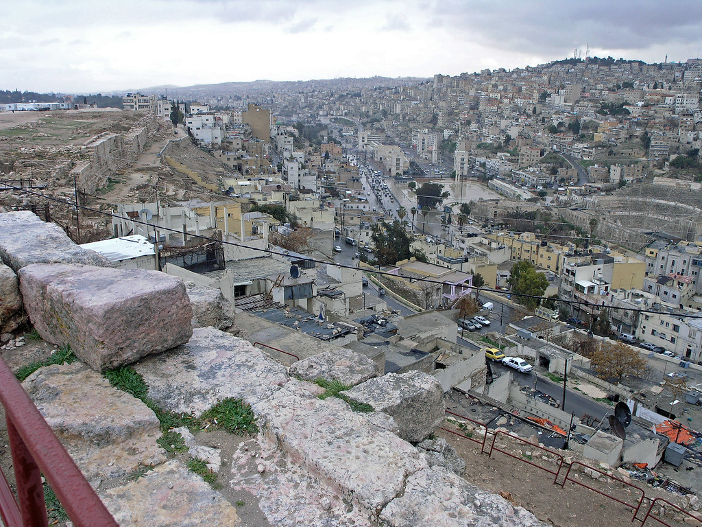 Feb 17.  Amman, Jordan, one of the oldest inhabited places in the world.  In the Bible it is Rabbath-Ammon, the capital of the Ammonites.  Amman was originally built on seven hills.  The ancient city wall is on the left.  In the valley to the right is the amphitheater, which we will visit tomorrow.  Behind us in this picture is an ancient temple, but no pictures.  We will see plenty of temples later.  Also, a museum is to the left in this picture.  We will visit that museum.