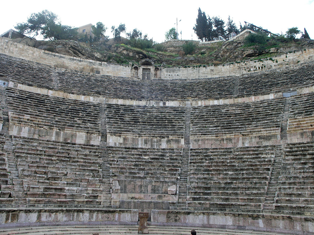 Feb 17.  The Ammon Roman Amphitheater is well preserved.  It is used today for various performances.  This amphitheater dates to the 2nd century and, like many ancient theaters, is set into the mountain.  Its 33 rows of seats can accommodate almost 6000 spectators.  This picture was made from the stage.  On either end of the stage is a museum: the Jordan Museum of Popular Traditions, and the Folklore Museum.