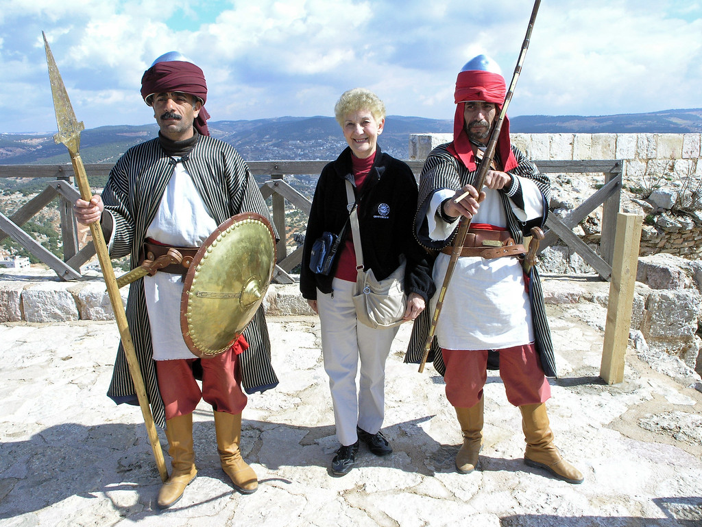 Feb 18.  On the highest part of the castle were these two guards, who made pictures with the tourists.  The one on the right said that if the picture is out of focus, this arrow goes through your heart.