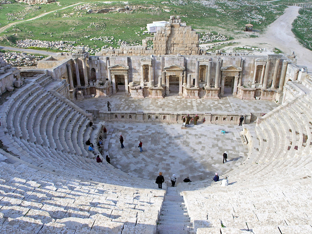 Feb 18.  I climbed to the top of the amphitheater for this picture.  Betty is sitting on the left on the end listening to our tour leader talk about the amphitheater.