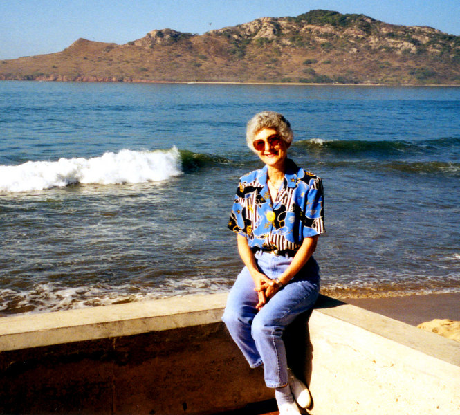 1999-02-18 01 Betty on the seawall at Playa Hotel.