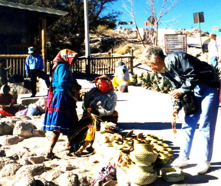 1999-02-20 11  These ladies had set up outside the hotel.  Betty bought a basket here.