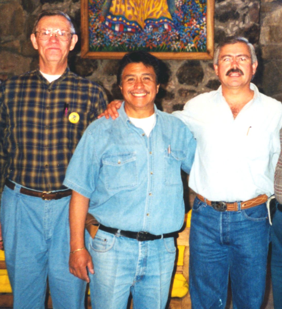 "1999-02-20 That afternoon--excitement!  Helicopters flew in raising dust.  With many soldiers came the Mexican ""Secretary of Defense,"" and also arriving separately, Mexico's Minister of Tourism.  ""Come quick,"" said Vincent our guide (middle), ""take my picture with Mr. Oscar Epanola.""  We had a pleasant talk, but never learned whether their visits were planned together or not.  The hotel people were excited too."