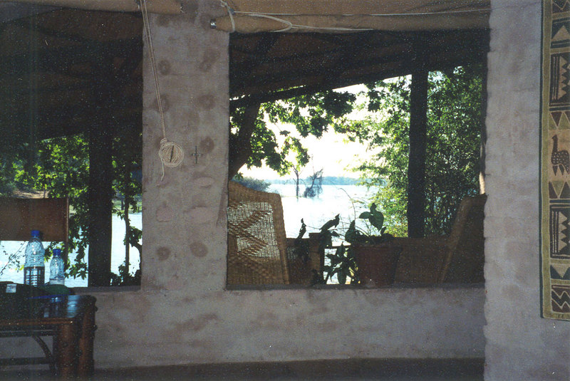 25 May.  From the bed in our room at Gauche Gauche Lodge, I took this picture.  The land drops away to this lake, where hippos swim and grunt.