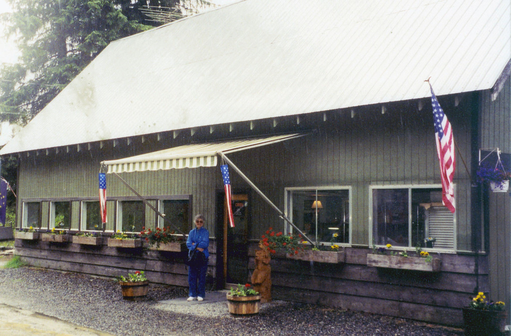 June 2.  Betty standing outside the Wildflour Coffee Shop in Hyder, Alaska.