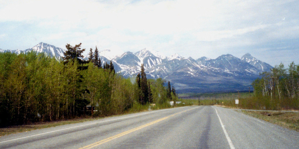 May 27.  The road between Whitehorse and Haines Junction, Yukon.  No real mountainous driving en route to Fairbanks but mountains frequently seen.