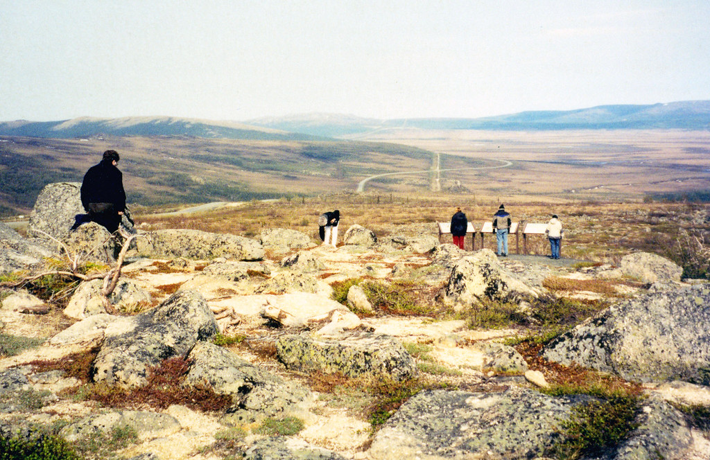 May 30.  Another stop at the area around Finger Mountain.  This is tundra and where there are no rocks, the soil is spongy.  Betty in the middle looking at the fragile tundra plants.