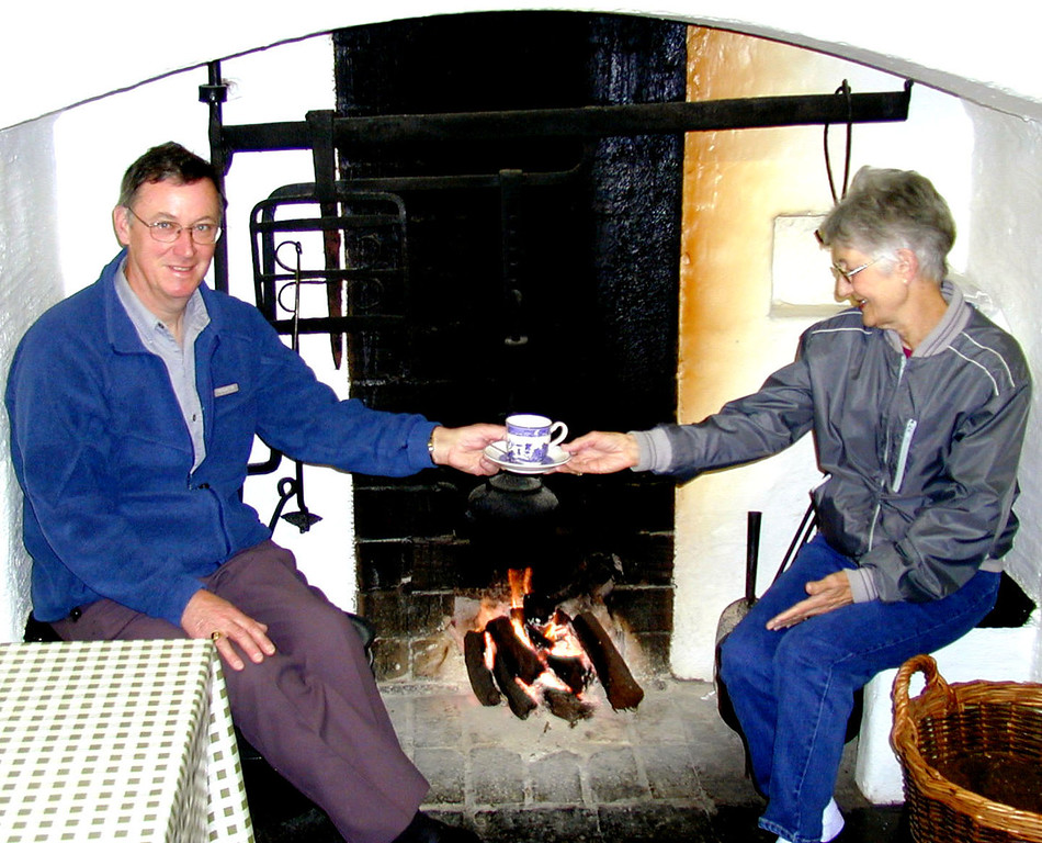 May 15.  We visited Craggaunowen, The Living Past, a reconstruction of a bronze age site.  In the gift shop we had tea.  Tom, our leader, said to take this picture of him giving Betty her tea.