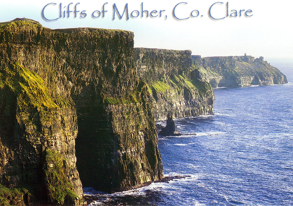 May 14.  Postcard of Cliffs of Moher.  We visited the tower on the right.  Some cliffs are 668 feet above sea level.