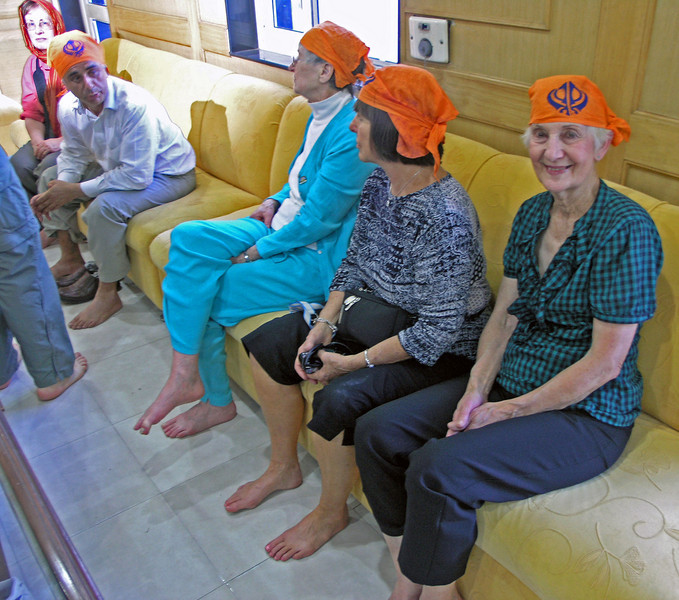 Feb 26.  We visited a Sikh temple.  One must not only remove shoes but both men and women must cover their heads.  The kerchief is supplied by the temple.