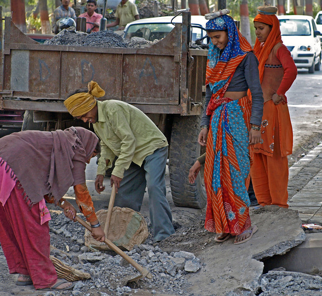 Feb 26.  We were heading to a Mahatma Gandhi monument and passed this construction site.  These ladies carry in baskets on their heads the rubble being dug up.