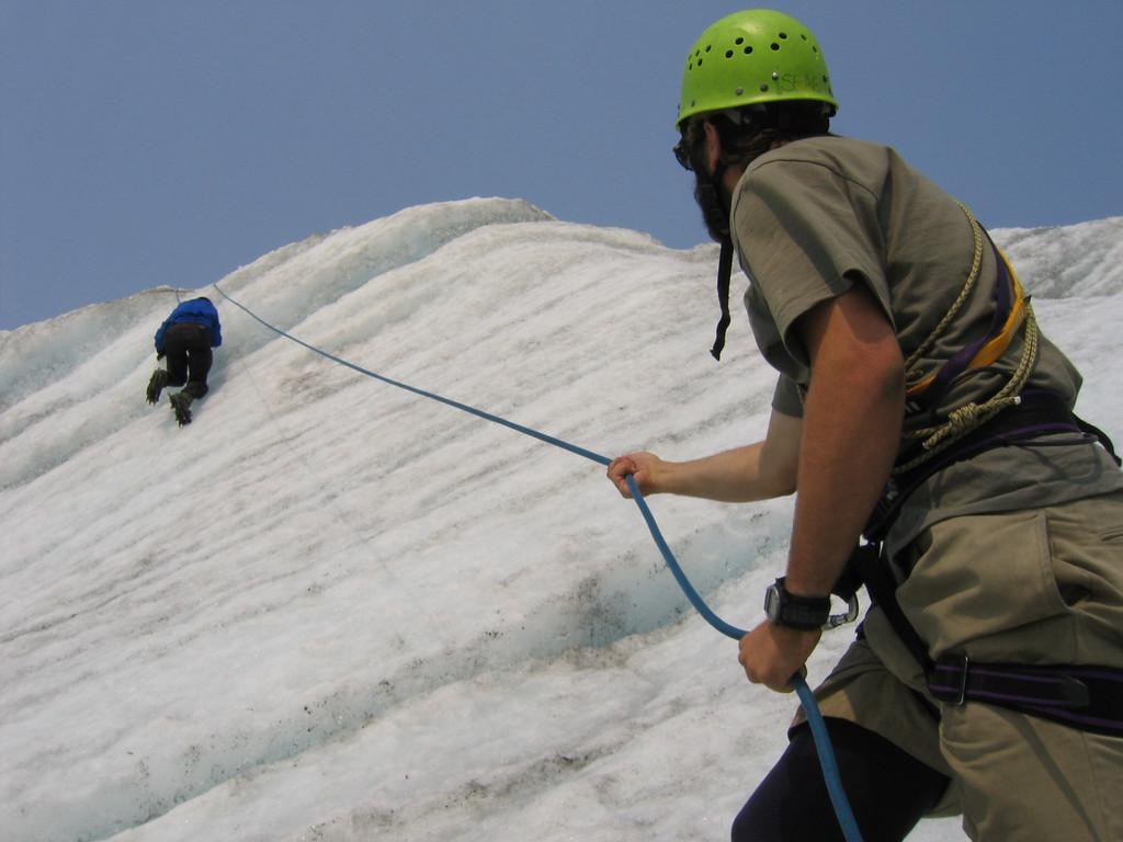 On belay ice climbing the Root glacier in Kennicot Alaska