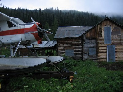 Sea Plane and wood house in the Yukon Territory, Canada