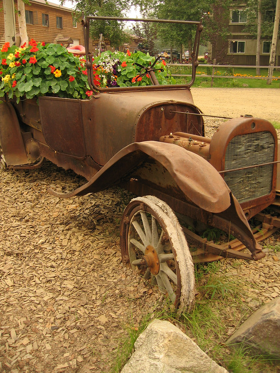 Old fashioned car with flowers in Cheena Hot Springs, Alaska