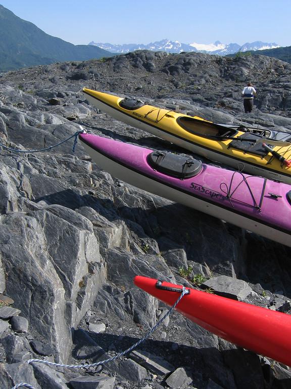 Kayaks on rocks at Shoup Glacier in Valdez Alaska