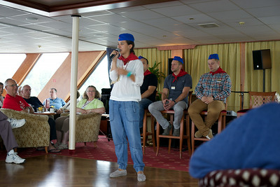Travel guide Melinda in young communist cap & scarf relates her family's personal experience with communism