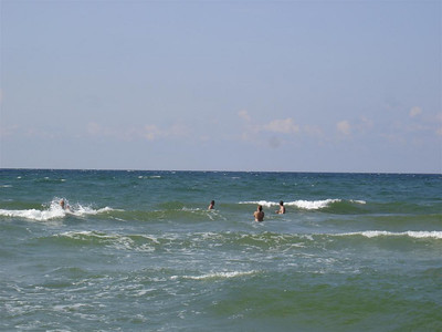 Lithuania: Surfing in the Baltic! We found amber on the beach too!
