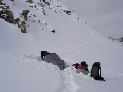 Kyrgyzstan: This is where it all went down. Our most near, near death experience was getting up to this point, surviving the night of camping in the snow and then descending safely the following day. We had to walk off up to the right to avoid the huge, yawning crevace just below us. We slid over the narrow snow bridge and then had hard walking for 10 more hours to get to the treeline where we could have a fire. Oh and this is where we got engaged.