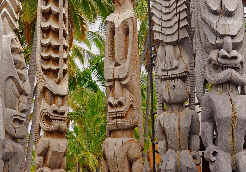 Hawaiian tiki-man carvings at Hiki-au Heiau park.