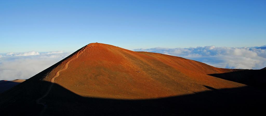 Sun hits hill top at top of Mauna Kea