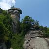 Chimney Rock-- man scaling cliff near entrance