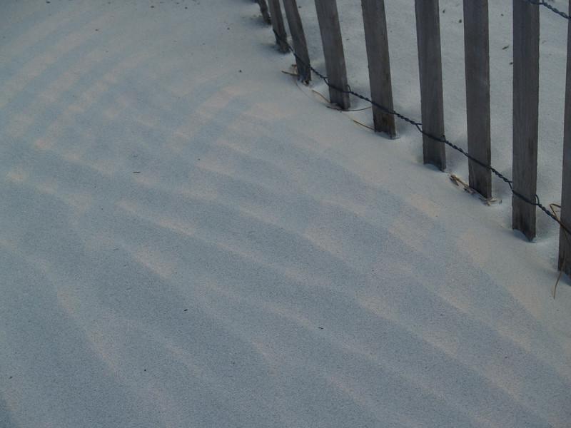Fence, sand, & light patterns at dusk