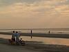 Boys & dog by sea, sunrise