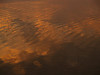 Sunrise reflections in sea, Hunting Island