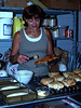 Bonnie Troyer, baking cinnamon rolls at Troyer's Country Amish Blatz