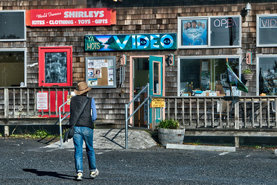 Beside watching the stoplight change, the Ya Hots Video store offers alternative entertainment.